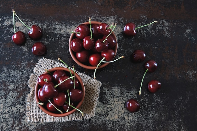 Fresh large sweet cherries. sweet cherries in bowls. vitamin concept.
