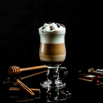 Fresh latte with cream and coffee beans