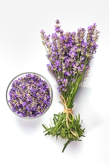 Fresh lavender bunch and lavender flowers in glass bowl.