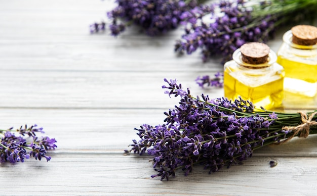 Fresh lavender flowers and essential oils in bottles