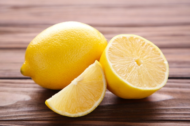 Fresh lemon on brown background. tropical fruit.