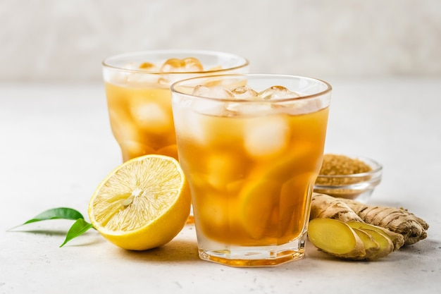Fresh lemon honey iced ginger tea in glasses.