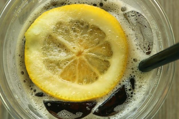 Fresh lemon slice on the iced cola soft drink