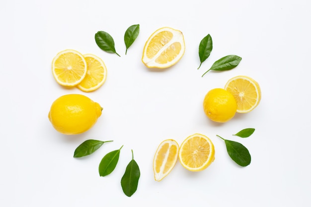 Fresh lemon with green leaves background