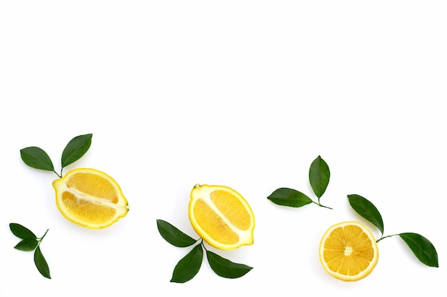 Fresh lemon with green leaves isolated