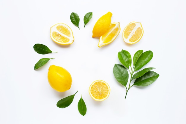 Fresh lemon with green leaves.