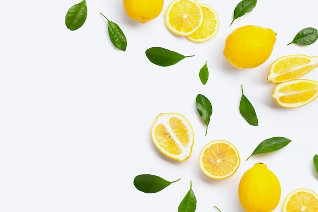 Fresh lemon with green leaves