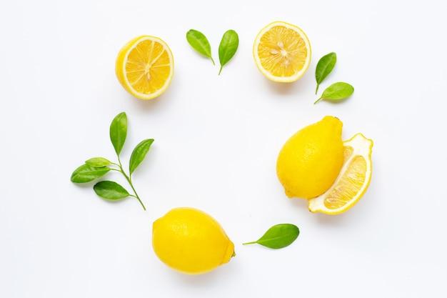 Fresh lemon with leaves isolated on white