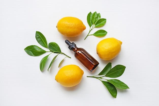 Fresh lemon with lemon essential oil.