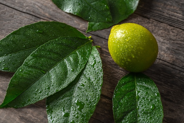 Fresh lemon on wooden background