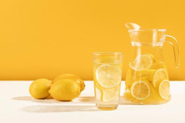 Fresh lemonade in glass on table