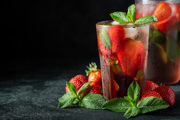 Fresh lemonade with ice, mint and strawberry.