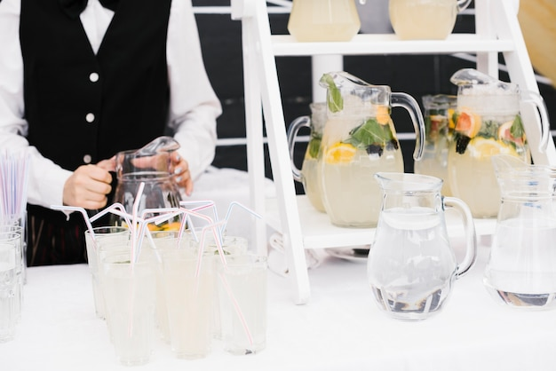 Fresh lemonade with straws on the table