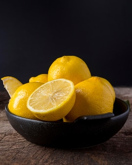 Fresh lemons in bowl arrangement