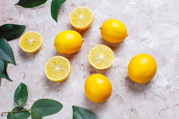 Fresh lemons on light surface,top view