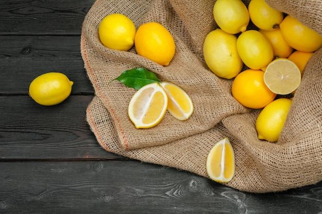 Fresh lemons on wooden table.