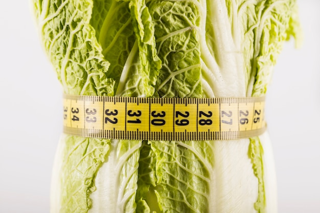 Fresh lettuce tied with measuring tape