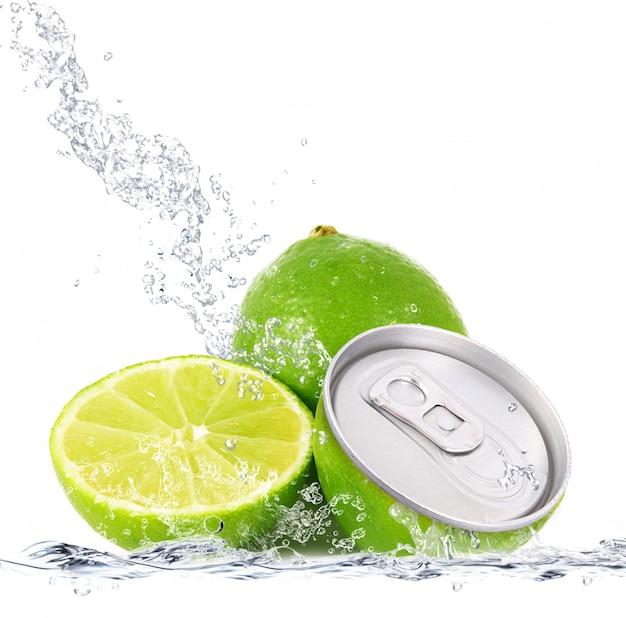 Fresh lime falling in water