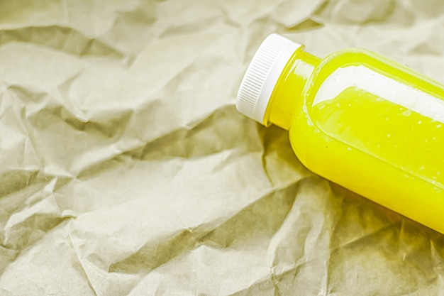 Fresh lime or lemon juice in ecofriendly recyclable plastic bottle and packaging healthy drink and f...