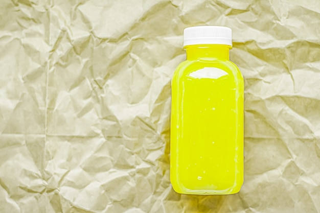 Fresh lime or lemon juice in ecofriendly recyclable plastic bottle and packaging healthy drink and food product concept
