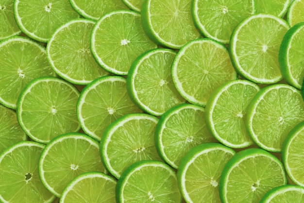 Fresh lime slices as a background.