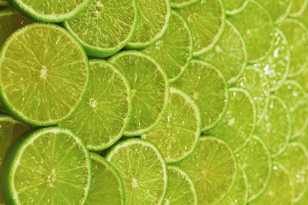 Fresh lime slices background.