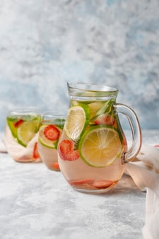 Fresh lime, strawberry and mint infused water, cocktail, detox drink, lemonade. summer drinks. health care concept.