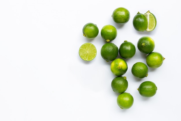 Fresh limes isolated on white background.