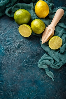 Fresh limes with citrus juicer stick.
