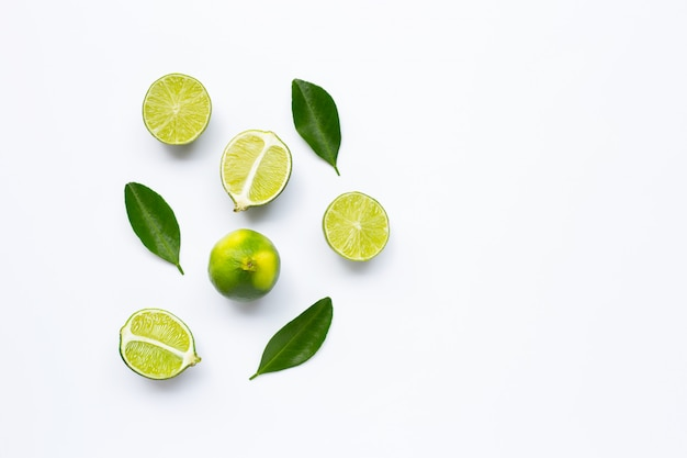 Fresh limes with leaves isolated and copyspace