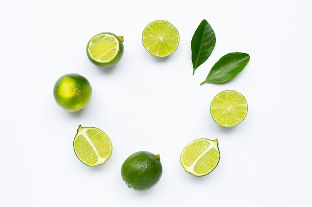 Fresh limes with leaves rounded composition isolated