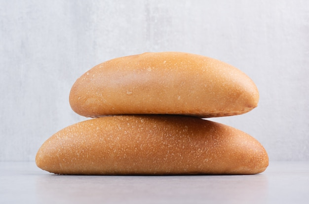 Fresh loaf bread on stone background. high quality photo
