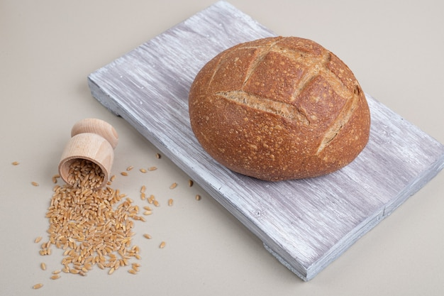 Fresh loaf of bread with oat grains on white background. high quality photo
