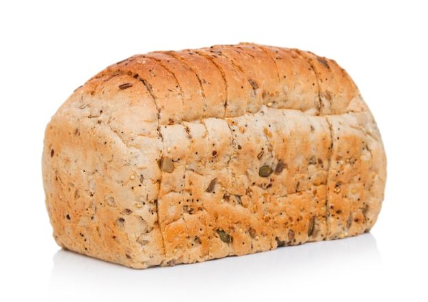 Fresh loaf of seeded bread on white.