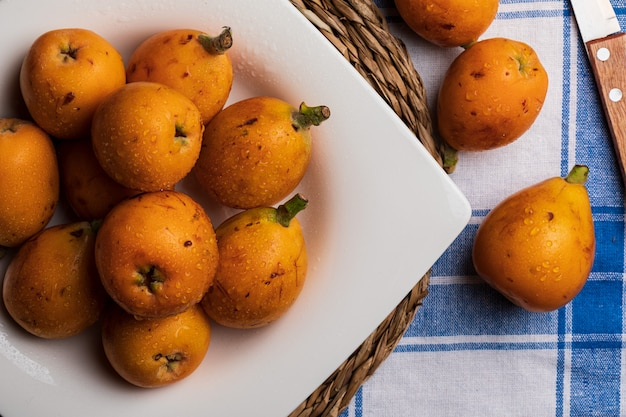 Fresh loquat fruits on a plate