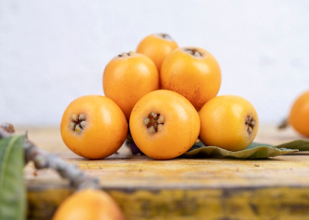 Fresh loquats on wooden table