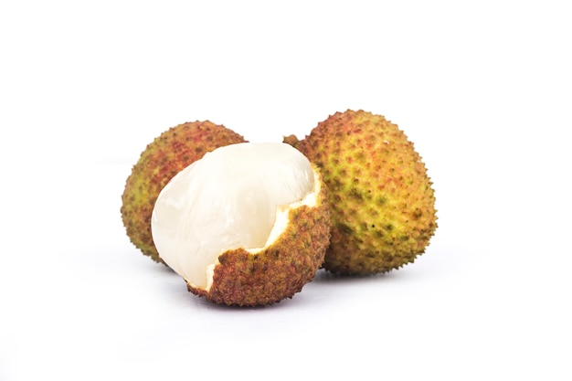 Fresh lychee with leaves isolated on white
