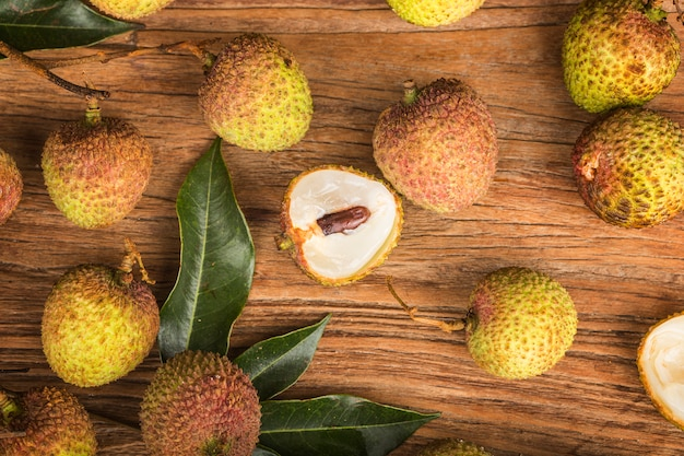 Fresh lychees on a wooden board