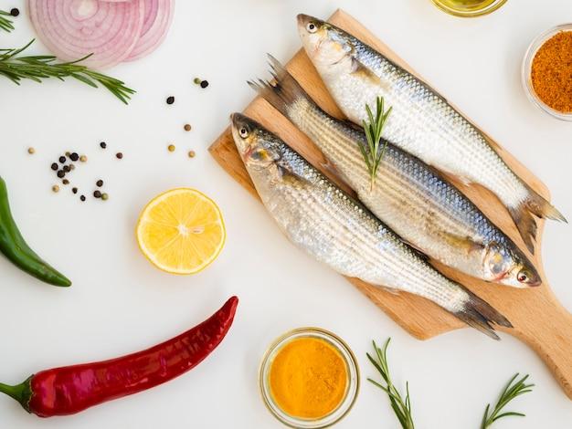 Fresh mackerels on a wooden board