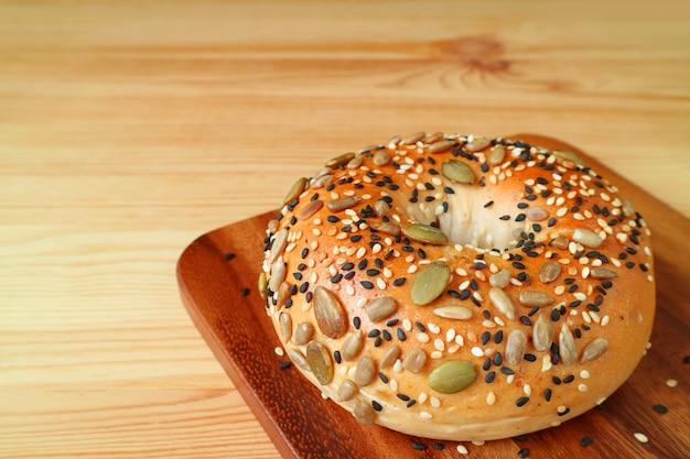 Fresh made bread with pumpkin seeds, sunflower seeds and sesame on wooden tray