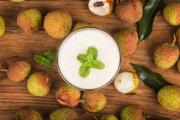 Fresh made lychee juice on wooden