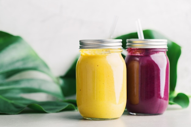 Fresh made smoothies in jars on table