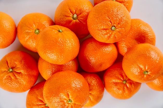 Fresh mandarin or tangerines on white background.