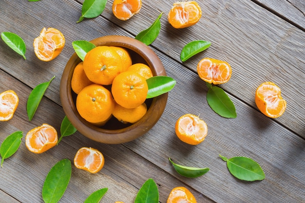 Fresh mandarins in wooden bowl