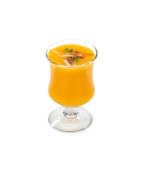 Fresh mango fruit juice on white background