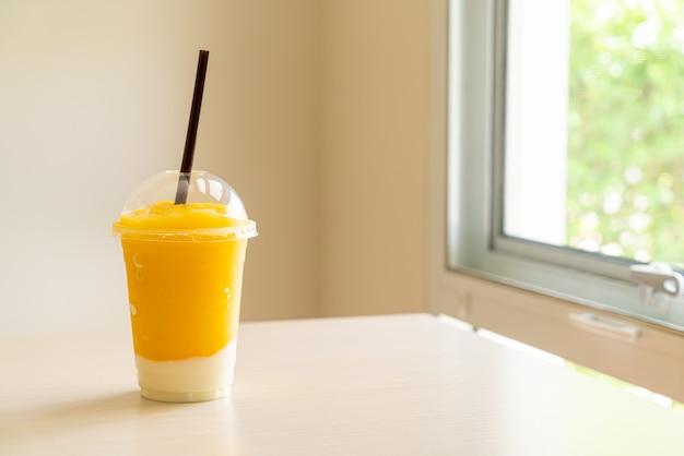 Fresh mango fruit smoothies with yogurt glass
