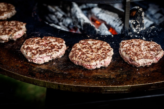 Fresh meat cutlets in a frying pan grill. cooking a grilled burger