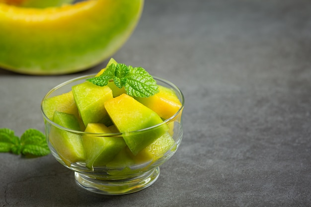 Fresh melon, cut into pieces, put in glass bowl