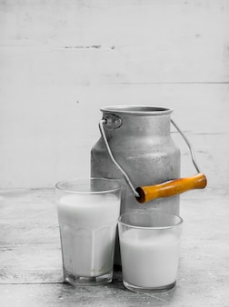 Fresh milk in a can. on a rustic.