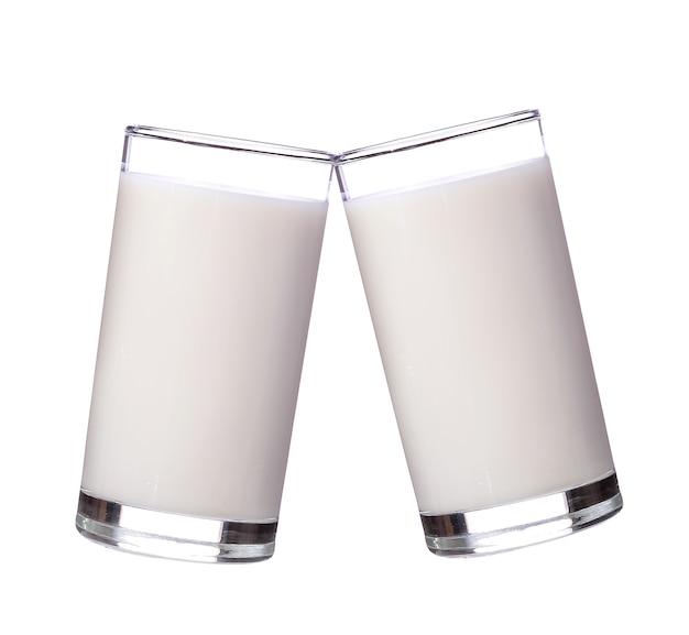 Fresh milk in the glass on white